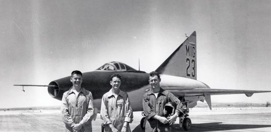 """26 Mar 1951 at Edwards Air Force Base - Filming began on the lakebed for RKO's film Jet Pilot, starring John Wayne and Janet Leigh. As shown in this photo, an XF-92A was painted to simulate a """"MiG-23."""" Most of aerial stunt scenes were anonymously flown by Chuck Yeager. (Edwards History Office file photo)"""